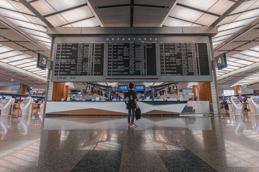 Standing at the departure board - how to avoid the US travel ban